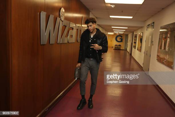 Kelly Oubre Jr #12 of the Washington Wizards arrives before the game against the New York Knicks on January 3 2018 at Capital One Arena in Washington...
