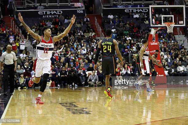 Kelly Oubre Jr #12 of the Washington Wizards celebrates after the Wizards scored on the Atlanta Hawks in the second half of their 10998 win at...