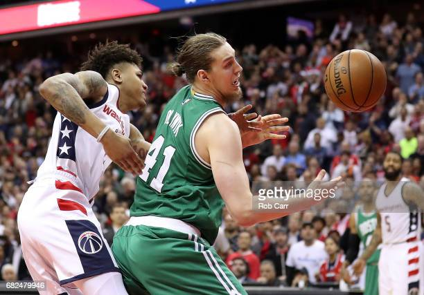 Kelly Oubre Jr #12 of the Washington Wizards defends against Kelly Olynyk of the Boston Celtics during Game Six of the NBA Eastern Conference...