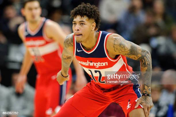 Kelly Oubre Jr #12 of the Washington Wizards defends against the Minnesota Timberwolves during the game on November 28 2017 at the Target Center in...