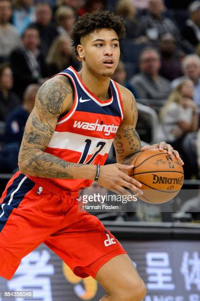 Kelly Oubre Jr #12 of the Washington Wizards dribbles the ball against the Minnesota Timberwolves during the game on November 28 2017 at the Target...