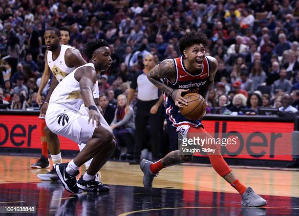 Kelly Oubre Jr #12 of the Washington Wizards dribbles the ball as OG Anunoby of the Toronto Raptors defends during the first half of an NBA game at...