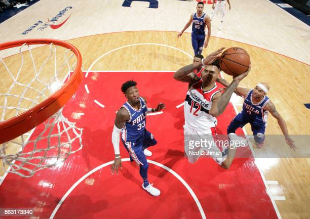 Kelly Oubre Jr #12 of the Washington Wizards drives to the basket against the Philadelphia 76ers on October 18 2017 at Capital One Arena in...
