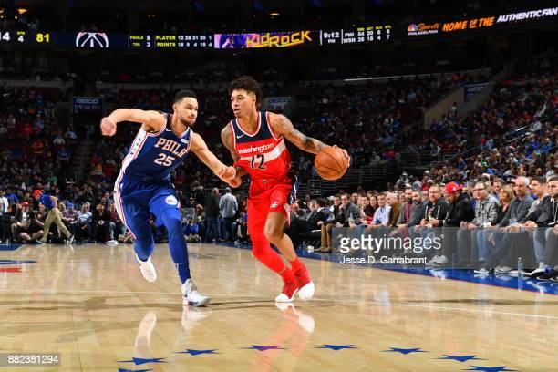Kelly Oubre Jr #12 of the Washington Wizards drives to the basket against the Philadelphia 76ers at Wells Fargo Center on November 29 2017 in...
