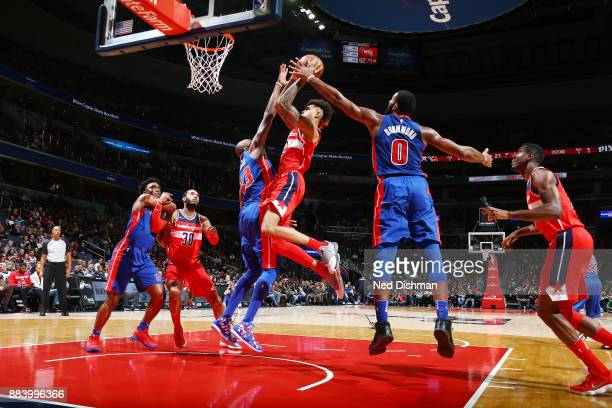Kelly Oubre Jr #12 of the Washington Wizards drives to the basket against the Detroit Pistons on December 1 2017 at Capital One Arena in Washington...