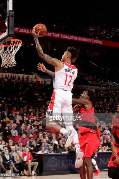 Kelly Oubre Jr #12 of the Washington Wizards drives to the basket against the Portland Trail Blazers on December 5 2017 at the Moda Center in...