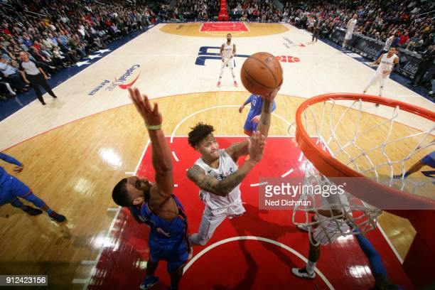 Kelly Oubre Jr #12 of the Washington Wizards drives to the basket against the Oklahoma City Thunder on January 30 2018 at Capital One Arena in...