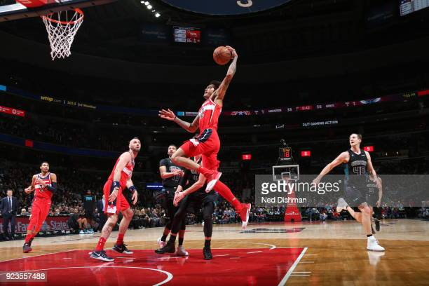 Kelly Oubre Jr #12 of the Washington Wizards dunks against the Charlotte Hornets on February 23 2018 at Capital One Arena in Washington DC NOTE TO...