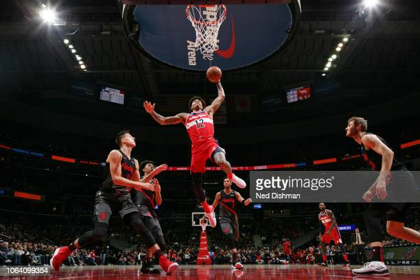 Kelly Oubre Jr #12 of the Washington Wizards dunks the ball against the Portland Trail Blazers on November 18 2018 at Capital One Arena in Washington...
