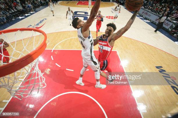 Kelly Oubre Jr #12 of the Washington Wizards dunks the ball during the game against the Milwaukee Bucks on January 15 2018 at Capital One Arena in...