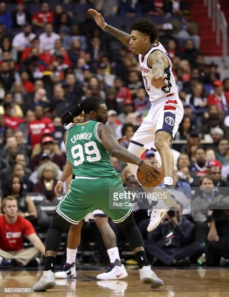 Kelly Oubre Jr #12 of the Washington Wizards fouls Jae Crowder of the Boston Celtics during Game Six of the NBA Eastern Conference SemiFinals at...
