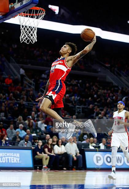 Kelly Oubre Jr. #12 of the Washington Wizards gets in for a first half dunk while playing the Detroit Pistons at the Palace of Auburn Hills on...