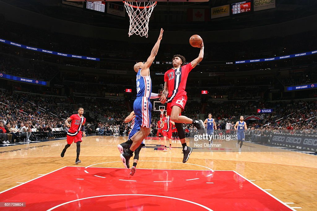 Kelly Oubre Jr. #12 of the Washington Wizards goes to the basket against the Philadelphia 76ers on January 14, 2017 at Verizon Center in Washington, DC.