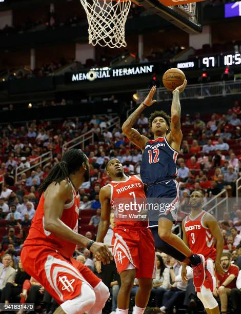 Kelly Oubre Jr #12 of the Washington Wizards goes up for a shot defended by Joe Johnson and Nene Hilario of the Houston Rockets in the second half at...