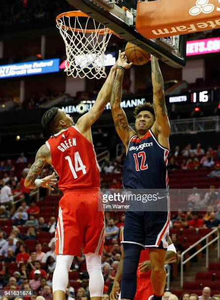 Kelly Oubre Jr #12 of the Washington Wizards goes up for a shot defended by Gerald Green of the Houston Rockets in the second half at Toyota Center...