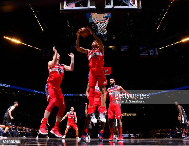 Kelly Oubre Jr #12 of the Washington Wizards grabs the rebound against the Brooklyn Nets on December 12 2017 at Barclays Center in Brooklyn New York...