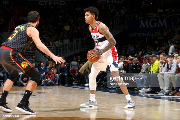 Kelly Oubre Jr #12 of the Washington Wizards handles the ball against the Atlanta Hawks on November 11 2017 at Capital One Arena in Washington DC...