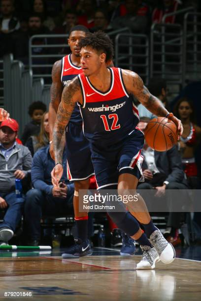 Kelly Oubre Jr #12 of the Washington Wizards handles the ball against the Portland Trail Blazers on November 25 2017 at Capital One Arena in...