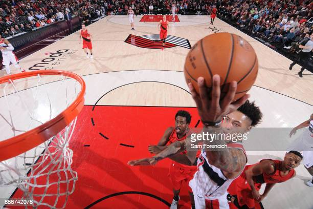 Kelly Oubre Jr #12 of the Washington Wizards handles the ball against the Portland Trail Blazers on December 5 2017 at the Moda Center in Portland...