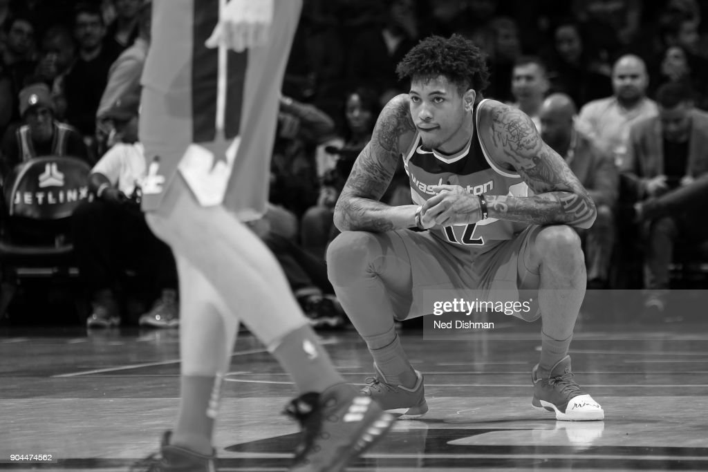 Kelly Oubre Jr. #12 of the Washington Wizards looks on during the game against the Orlando Magic on January 12, 2018 at Capital One Arena in Washington, DC.