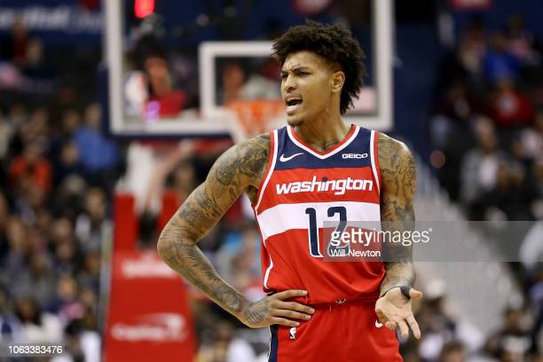 Kelly Oubre Jr #12 of the Washington Wizards reacts after a play during the second half against the Portland Trail Blazers at Capital One Arena on...