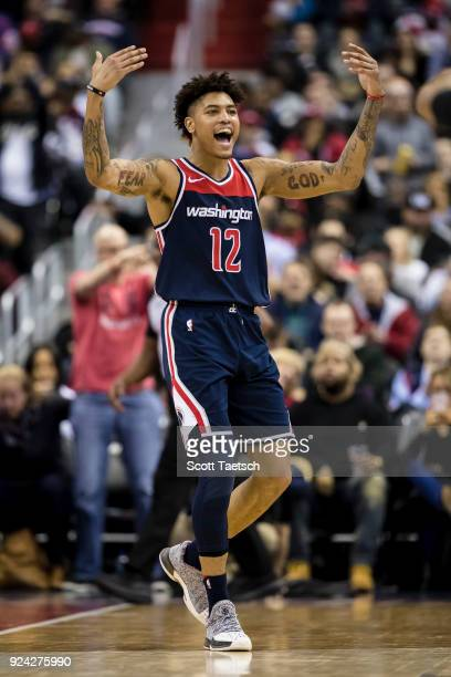 Kelly Oubre Jr #12 of the Washington Wizards reacts against the Philadelphia 76ers during the first half at Capital One Arena on February 25 2018 in...