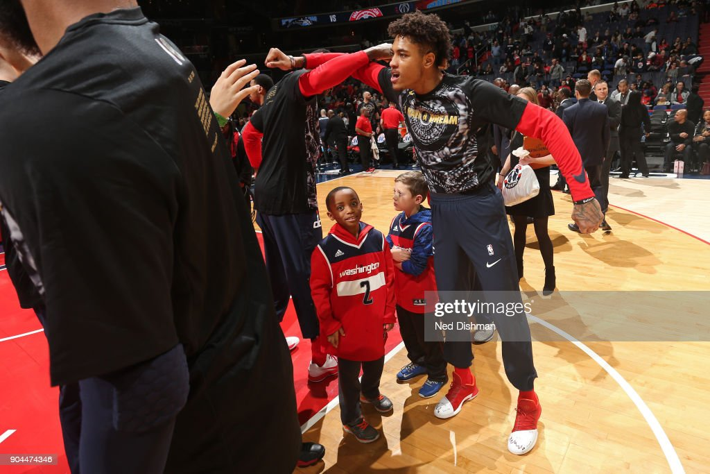 Kelly Oubre Jr. #12 of the Washington Wizards runs out before the game against the Orlando Magic on January 12, 2018 at Capital One Arena in Washington, DC.