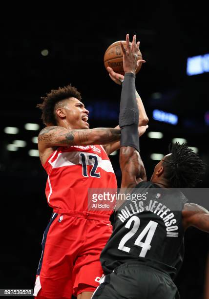 Kelly Oubre Jr #12 of the Washington Wizards shoots against Rondae HollisJefferson of the Brooklyn Nets during their game at Barclays Center on...