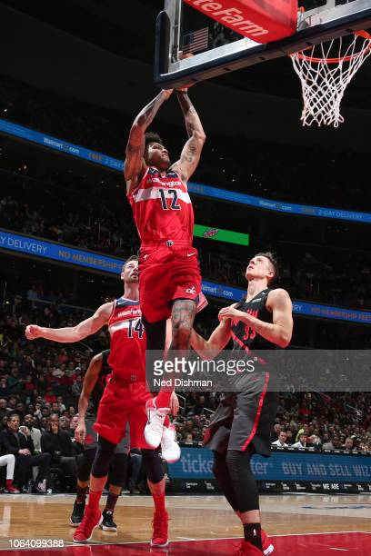 Kelly Oubre Jr #12 of the Washington Wizards shoots the ball against the Portland Trail Blazers on November 18 2018 at Capital One Arena in...