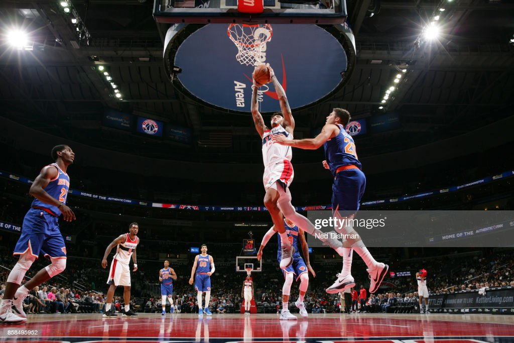 Kelly Oubre Jr. #12 of the Washington Wizards shoots the ball against the New York Knicks during the preseason game on October 6, 2017 at Capital One Arena in Washington, DC.