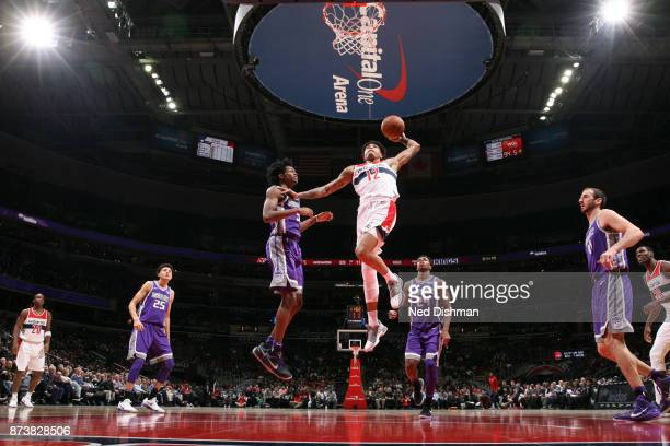 Kelly Oubre Jr #12 of the Washington Wizards shoots the ball against the Sacramento Kings on November 13 2017 at Capital One Arena in Washington DC...