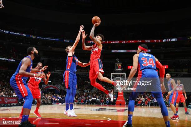 Kelly Oubre Jr #12 of the Washington Wizards shoots the ball against the Detroit Pistons on December 1 2017 at Capital One Arena in Washington DC...
