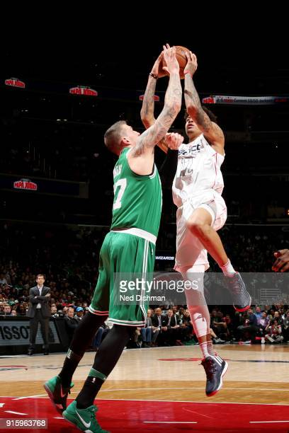 Kelly Oubre Jr #12 of the Washington Wizards shoots the ball against Daniel Theis of the Boston Celtics during the game between the two teams on...