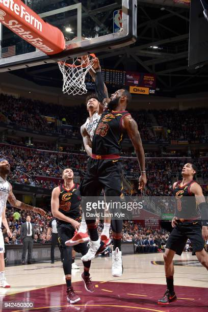 Kelly Oubre Jr #12 of the Washington Wizards shoots the ball as LeBron James of the Cleveland Cavaliers blocks on April 5 2018 at The Quicken Loans...
