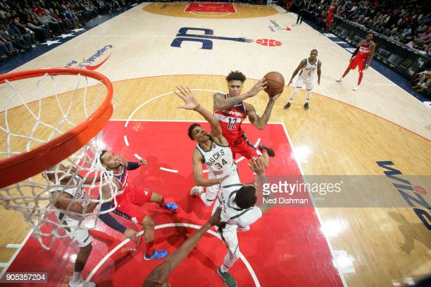 Kelly Oubre Jr #12 of the Washington Wizards shoots the ball during the game against the Milwaukee Bucks on January 15 2018 at Capital One Arena in...