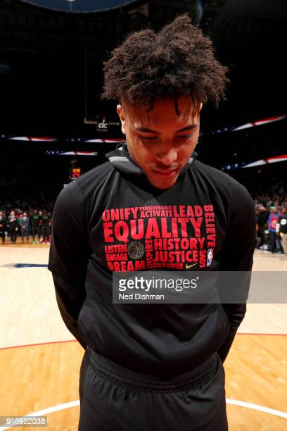 Kelly Oubre Jr #12 of the Washington Wizards stands for the national anthem prior to the game against the Boston Celtics on February 8 2018 at...