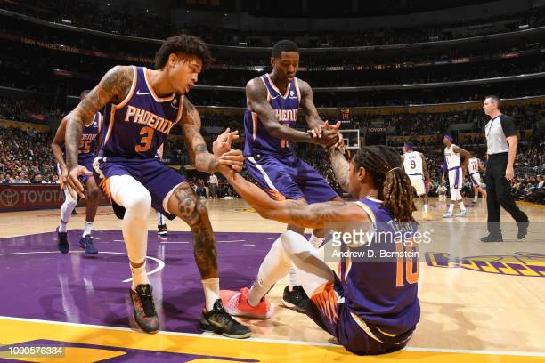 Kelly Oubre Jr #3 and Jamal Crawford help up Emanuel Terry of the Phoenix Suns during the game against the Los Angeles Lakers on January 27 2019 at...