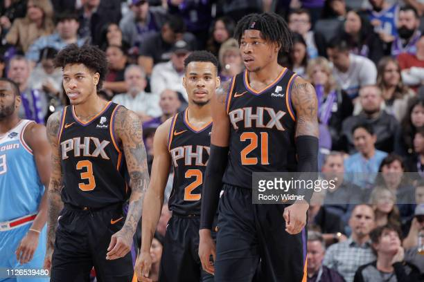 Kelly Oubre Jr #3 Elie Okobo and Richaun Holmes of the Phoenix Suns face the Sacramento Kings on February 10 2019 at Golden 1 Center in Sacramento...