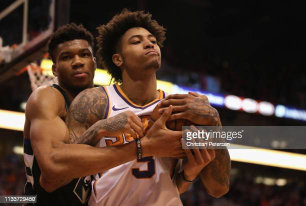 Kelly Oubre Jr #3 of the Phoenix Suns and Giannis Antetokounmpo of the Milwaukee Bucks hold the ball during the second half of the NBA game at...