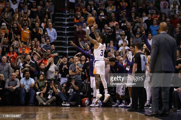 Kelly Oubre Jr #3 of the Phoenix Suns attempts a three point shot during the final moments of second half of the NBA game against the Utah Jazz at...