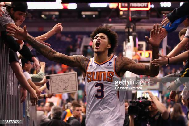 Kelly Oubre Jr #3 of the Phoenix Suns celebrates with fans after defeating the Milwaukee Bucks in the NBA game at Talking Stick Resort Arena on March...