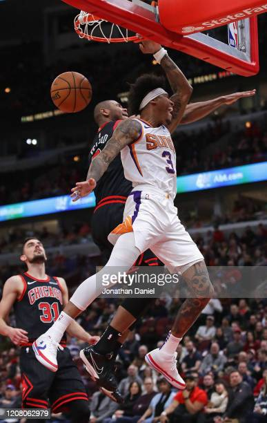 Kelly Oubre Jr #3 of the Phoenix Suns dunks against Cristiano Felicio and Tomas Satoransky of the Chicago Bulls at the United Center on February 22...