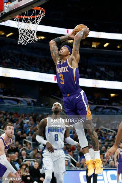 Kelly Oubre Jr #3 of the Phoenix Suns dunks against the Orlando Magic during the second half at Amway Center on December 04 2019 in Orlando Florida...