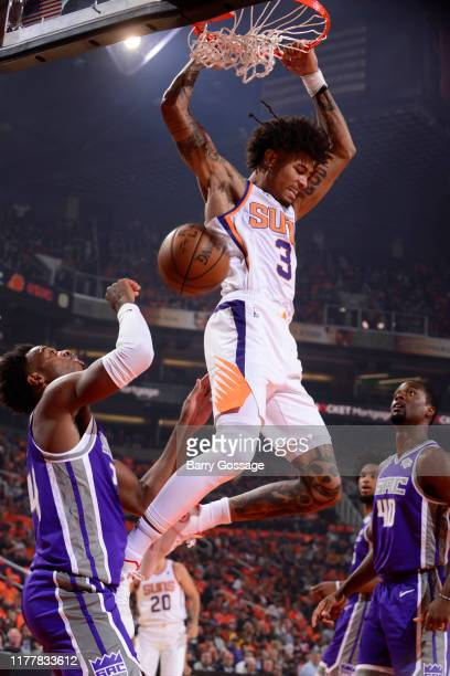 Kelly Oubre Jr #3 of the Phoenix Suns dunks the ball against the Sacramento Kings on October 23 2019 at Talking Stick Resort Arena in Phoenix Arizona...