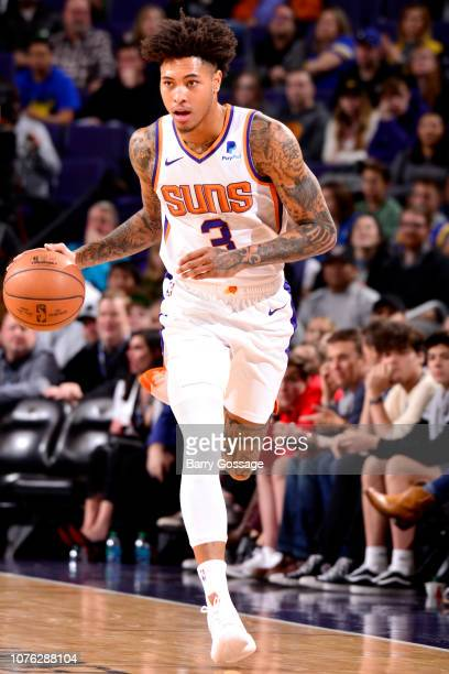 Kelly Oubre Jr #3 of the Phoenix Suns handles the ball against the Golden State Warriors on December 31 2018 at Talking Stick Resort Arena in Phoenix...