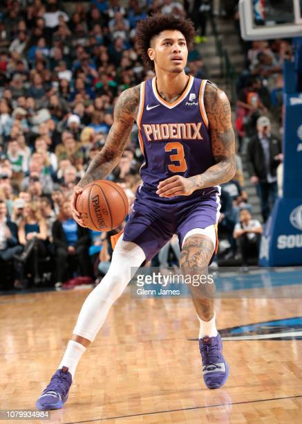 Kelly Oubre Jr #3 of the Phoenix Suns handles the ball against the Dallas Mavericks on January 9 2019 at the American Airlines Center in Dallas Texas...