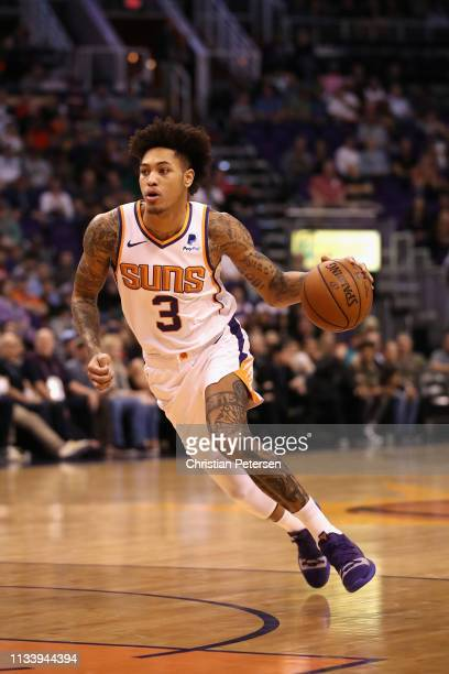 Kelly Oubre Jr #3 of the Phoenix Suns handles the ball during the first half of the NBA game against the Milwaukee Bucks at Talking Stick Resort...