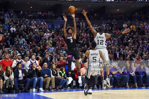 Kelly Oubre Jr #3 of the Phoenix Suns hits the three point basket to send the game into overtime against the San Antonio Spurs on December 14 2019 at...