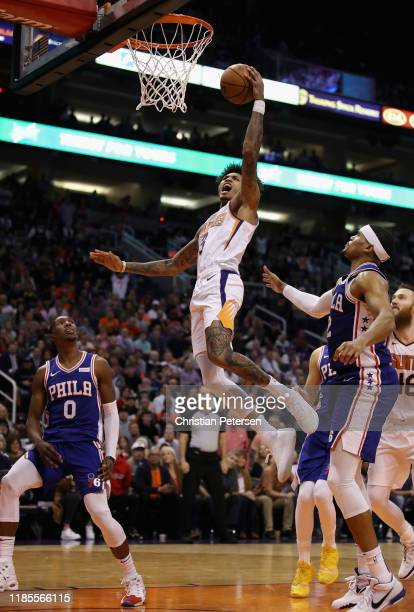 Kelly Oubre Jr #3 of the Phoenix Suns lays up a shot past Jared Harper of the Phoenix Suns during the second half of the NBA game at Talking Stick...