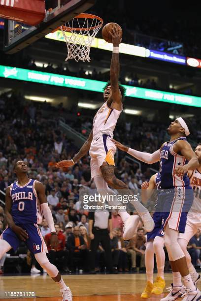 Kelly Oubre Jr #3 of the Phoenix Suns lays up a shot past Tobias Harris of the Philadelphia 76ers during the second half of the NBA game at Talking...